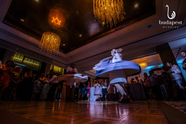 Most couples would like to incorporate some Hungarian elements into their wedding. We usually suggest some Hungarian folk dancers. They first have a 15 minute performance then they teach basic steps to the guests