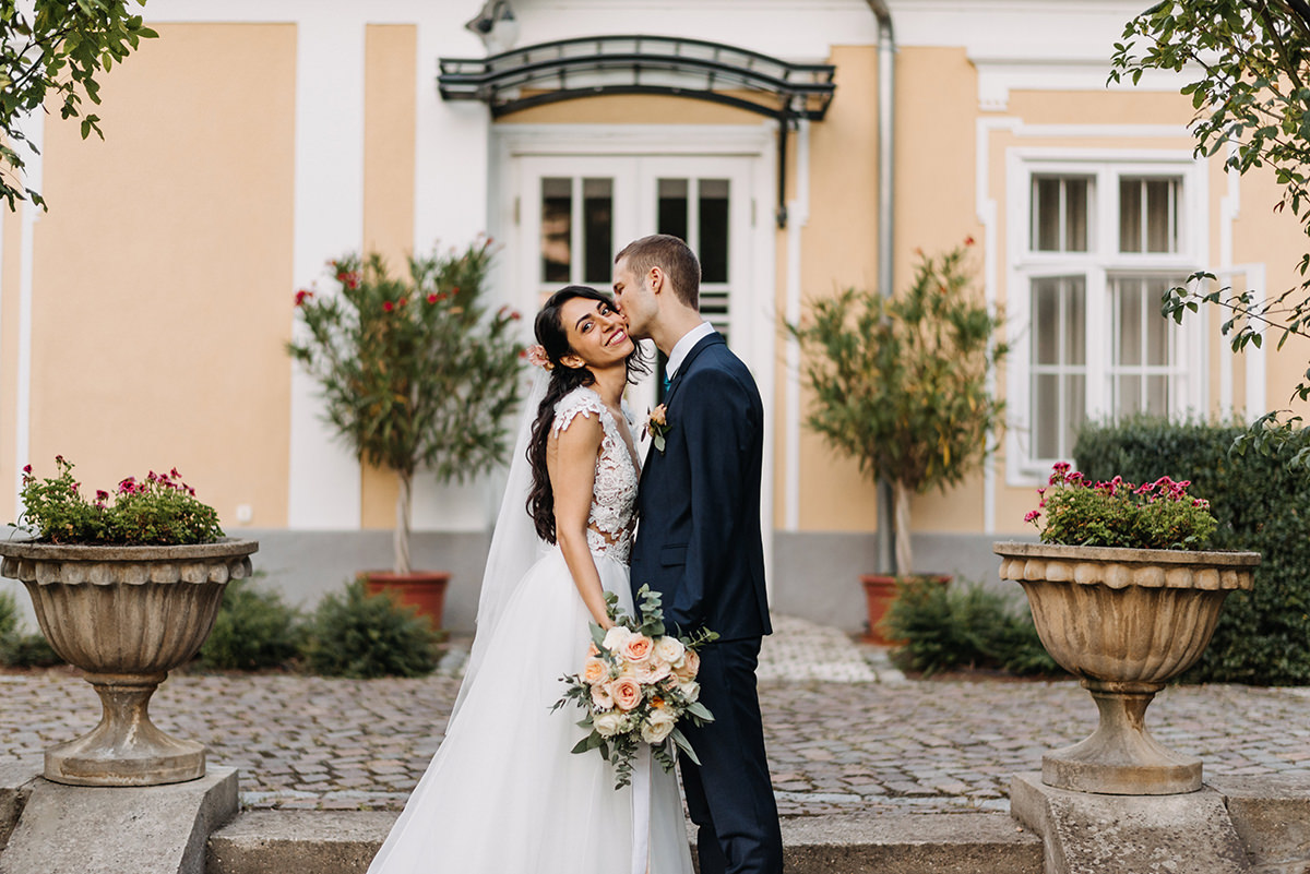 Creative photoshoot with the bride and groom in the garden of the Pronay Castle