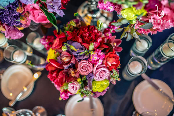 Close up picture of a very colourful wedding centrepiece