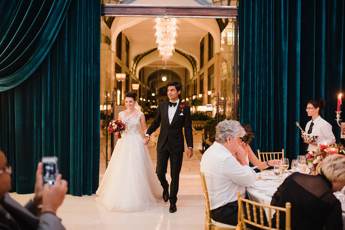 Pakistani groom and his Russian bride as they are coming into the Zrinyi Passage and guests welcoming the newlyweds in the Four Seasons Hotel, Gresham Palace