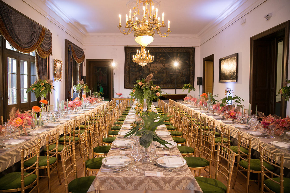 Three long guest tables with full of various kind of centrepieces