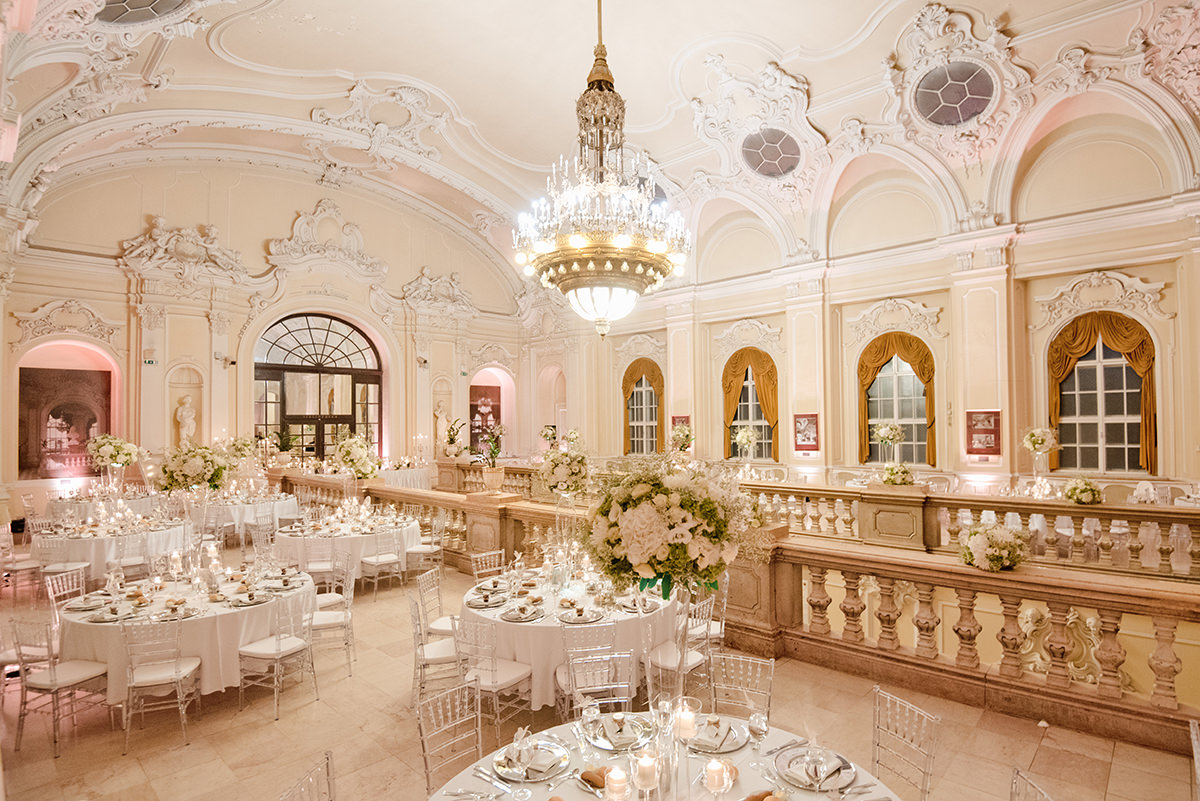 Showing the total capacity of the ballroom from a wider prospective with the huge chandelier in the middle just above the main entrance