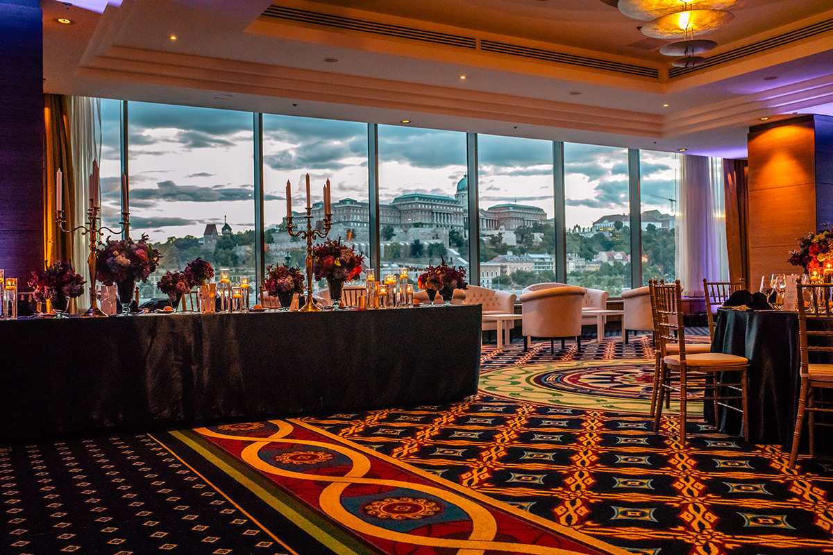Marriott Hotel, which is overlooking the entire Buda Castle and Savoy Terrace with long main table decoration and white lounge furniture
