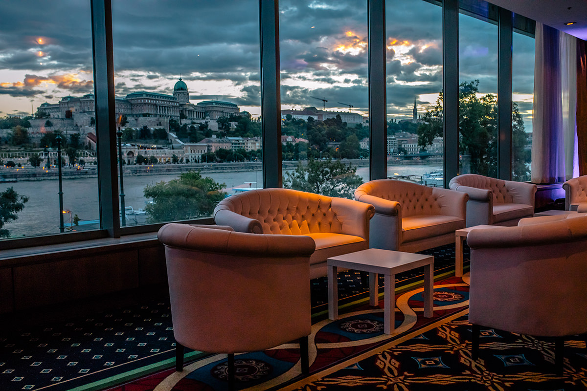 Lounge furniture by the window of the Marriott Hotel, which is overlooking the entire Buda Castle and Savoy Terrace