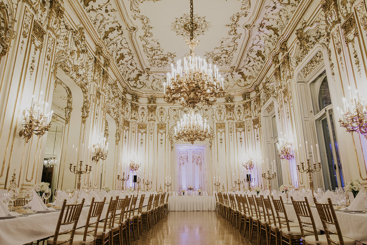 Golden room of the Wenckheim Palace with white and golden wedding decoration and some very light purple colour to emphasise the beauty of the room