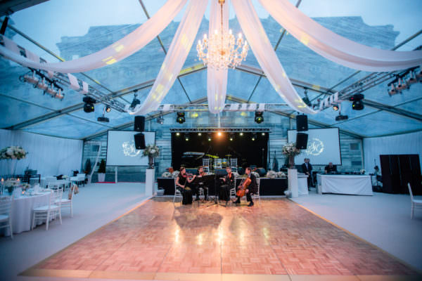 600 sqm full transparent wedding tent with beautiful wedding decoration, dance floor, lighting system and chandelier in the Lions' Court, Buda Castle