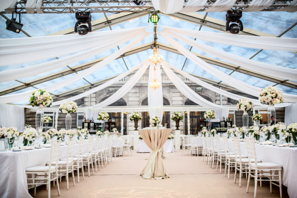 Wedding set up in the 600 sqm see through wedding tent with light beige colour decoration in the Lions' Court, Buda Castle