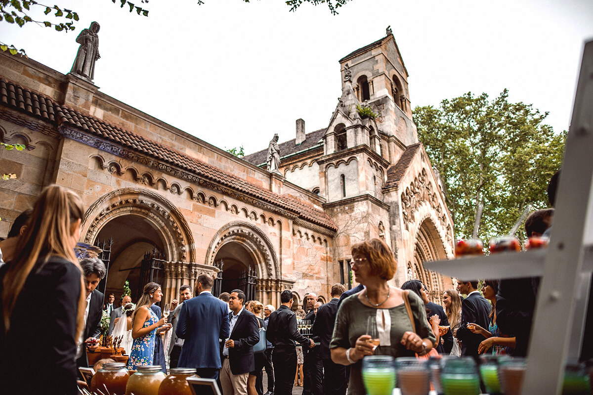 View of the standing reception in front of the Jaki Church which is the garden of the cloister, with different kind of creative food stations for canapés, mocktails, dates, Arabic coffee